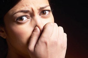 Woman pinching nose and covering mouth uid 1426320